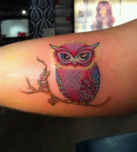 Colorful owl tattoo by Hania Sobieski