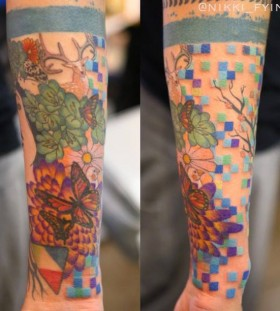 Colorful tattoo by Nikki Ouimette