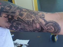 Cool tattoo with motorbike