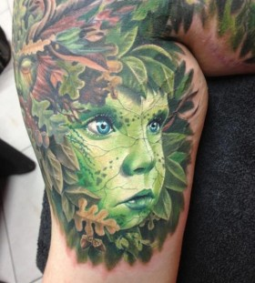 Cute green face tattoo