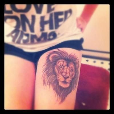 Cute tattoo with lion head