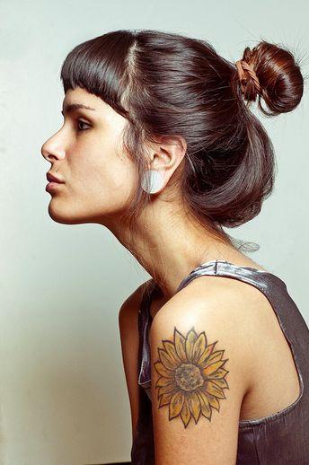 Cute woman sunflower tattoo