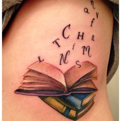 Few books tattoo with letters