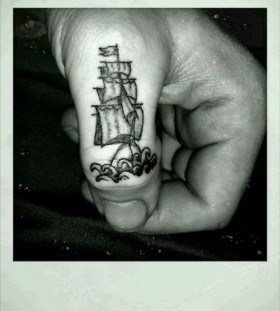 Finger ship tattoo
