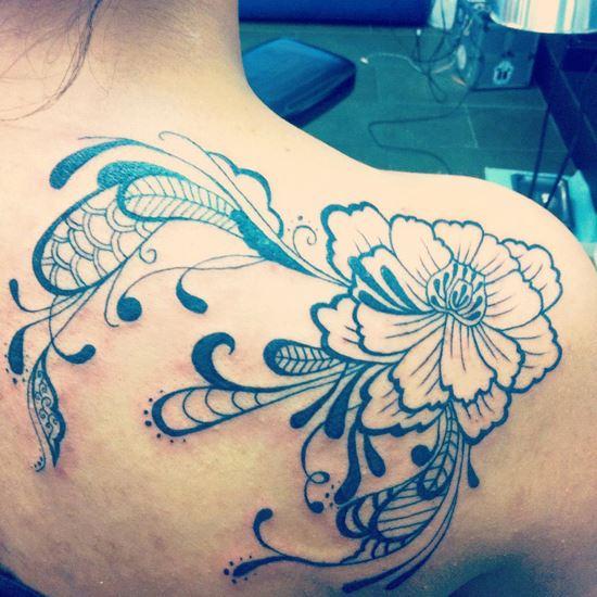 Flower tattoo by Nikki Ouimette