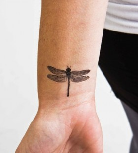 Flying bug tattoo