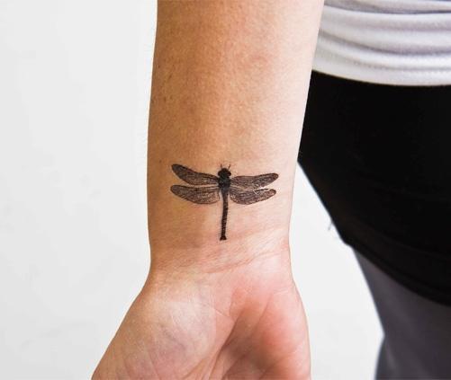 Flying bug tattoo