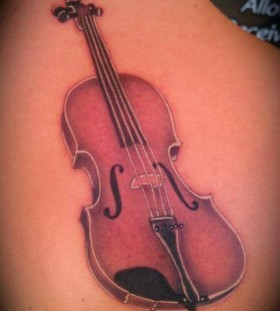 Guitar tattoo by Art Junkies