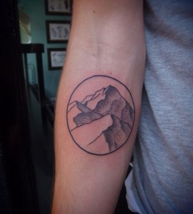 Hand mountains tattoo