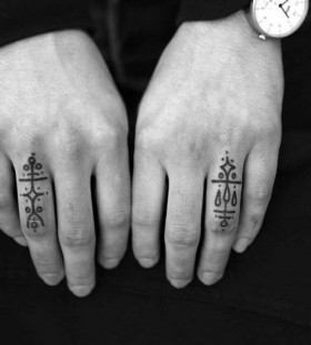 Hands fingers tattoo by Jean Philippe Burton