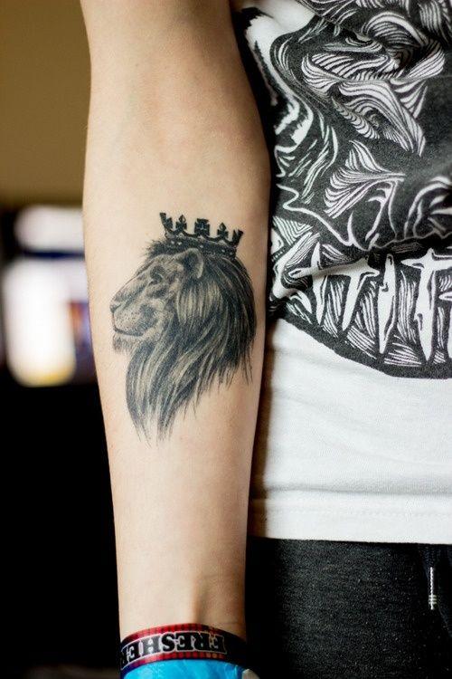 Hands lion tattoo