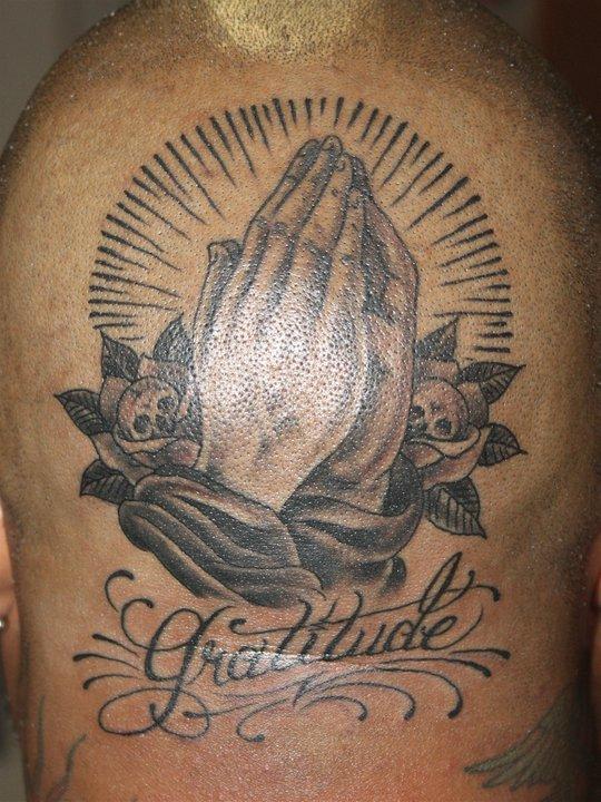 Hands tattoo by Mike Schweigert