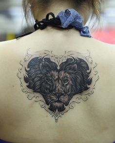 Heart lion tattoo