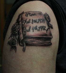 Impressive tattoo with red book