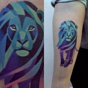 Lion purple tattoo