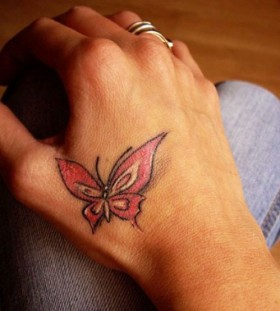 Little red butterfly sitting on the hand