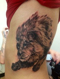 Old lion tattoo