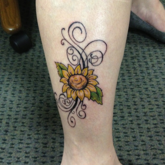 Ornaments and sunflower tattoo