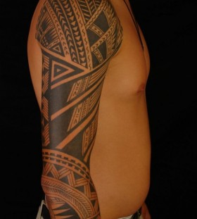 Polynesian tribal sleeve tattoo