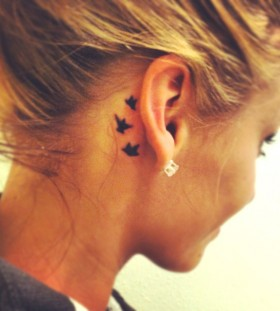 Pretty ear small tattoo