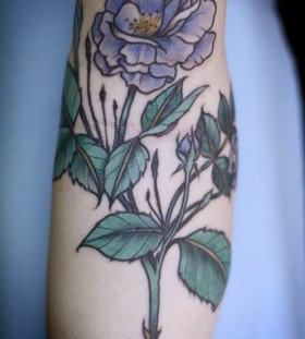 Purple flower tattoo by Alice Carrier