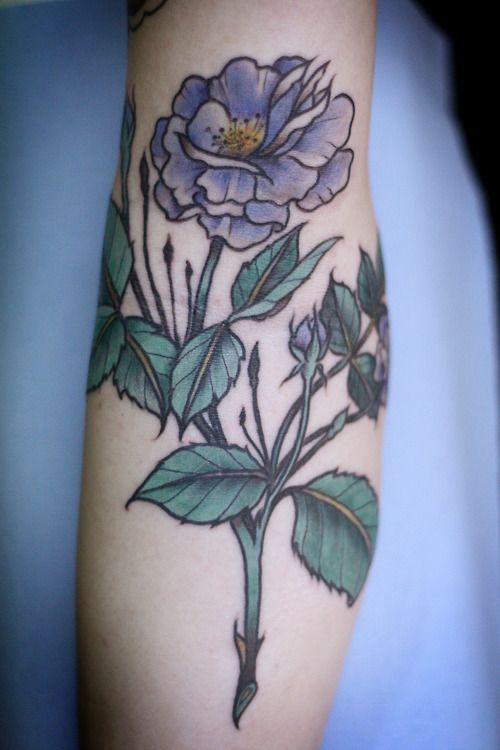 Purple flower tattoo by Alice Carrier
