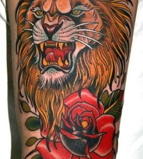 Red rose and lion tattoo