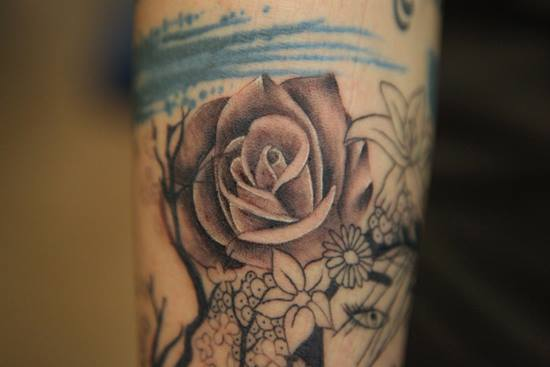 Rose tattoo by Nikki Ouimette