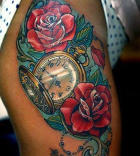 Roses and clock tattoo