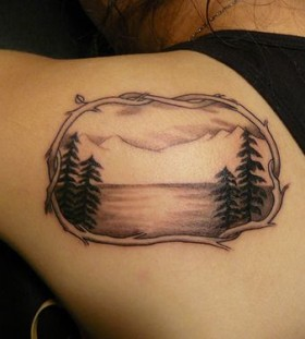 See and mountains tattoo