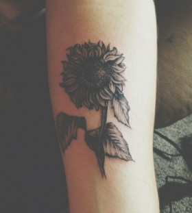 Simple black sunflower tattoo