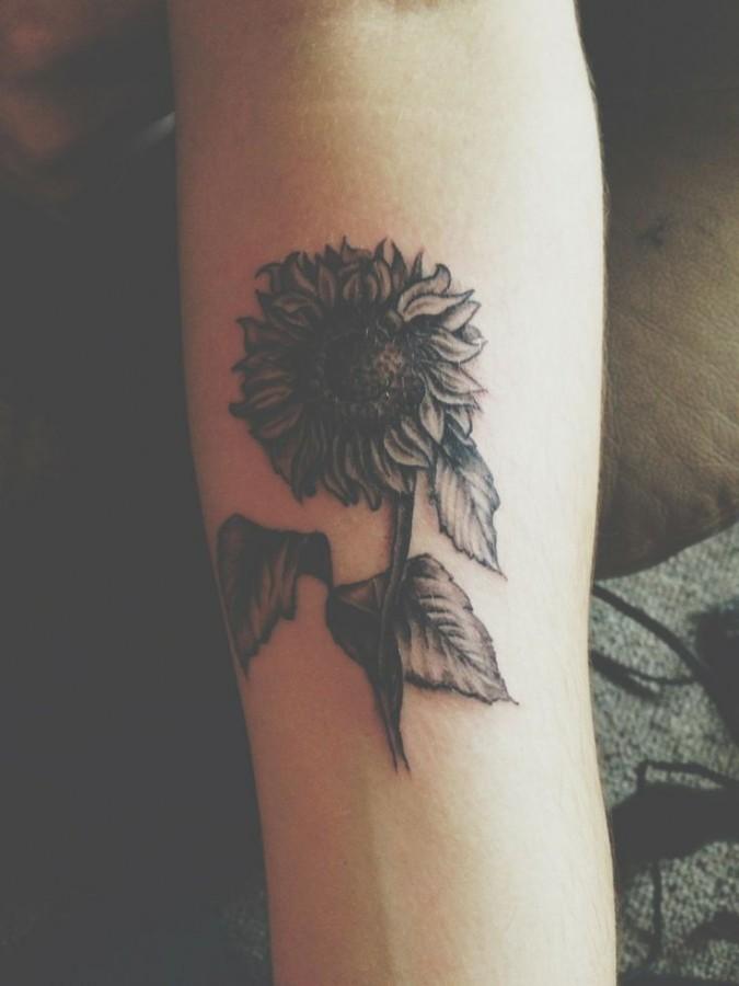 Simple black sunflower tattoo