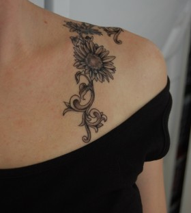 Small pretty sunflower tattoo