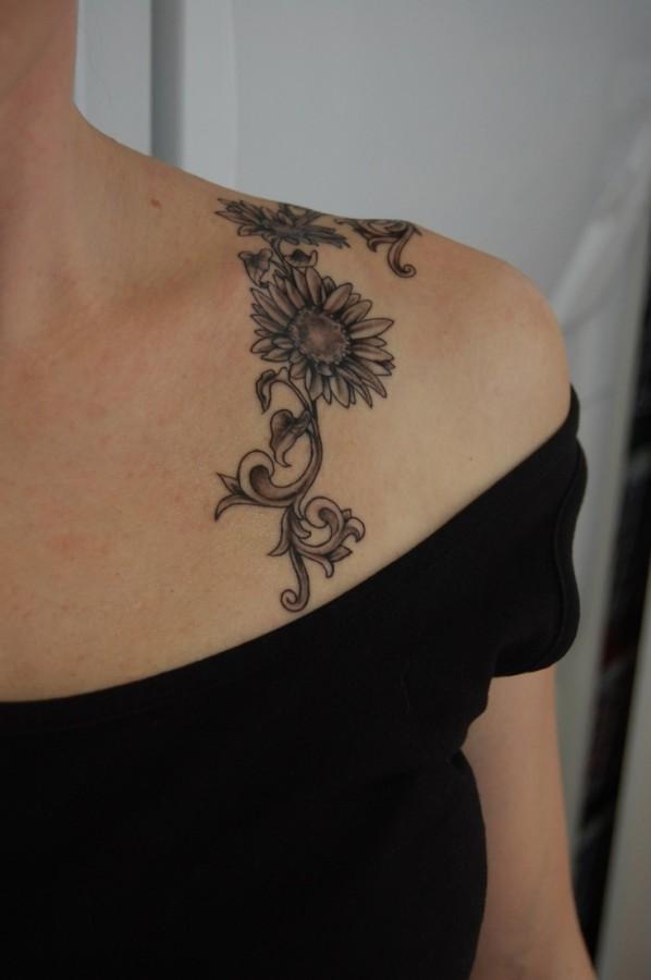 Small pretty sunflower tattoo