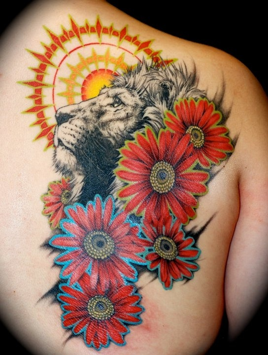 Sun and flowers lion tattoo