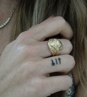 Tiny finger minimalistic style tattoo