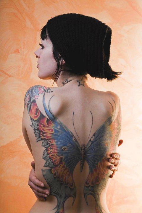 Woman back butterfly tattoo
