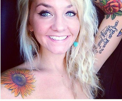 Woman sunflower tattoo