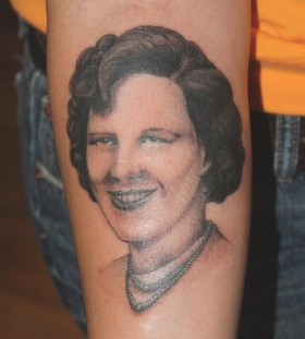 Woman tattoo by Mike Schweigert
