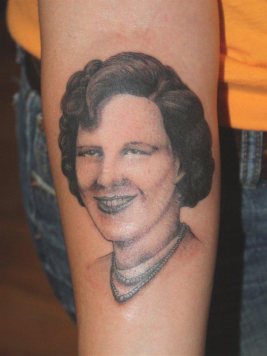 Woman tattoo by Mike Schweigert