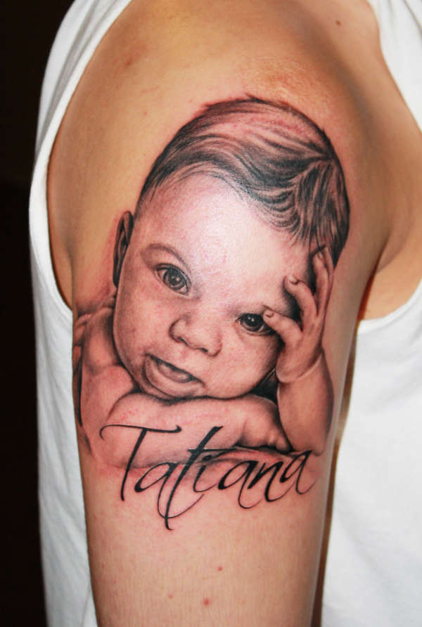 Wonderful tattoo with young baby