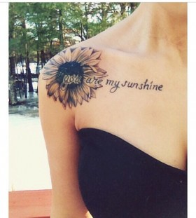 Words and sunflower tattoo