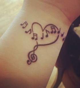 Wrist-heart-and-music-tattoo