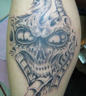 big alien tatto on arm
