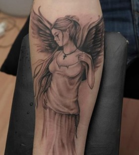 crying angel on arm