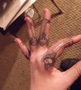 key-tattoo-on-fingers