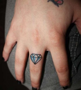 tiny diamond on finger