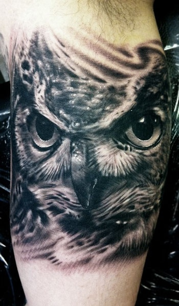 Adorable black owl tattoo