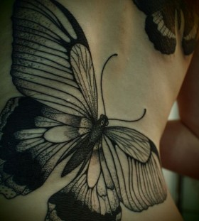 Adorable girl butterfly tattoo