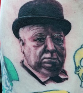 Alfred Hitchcok famous people tattoo
